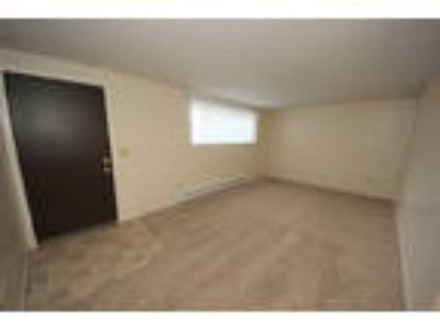 2 BR - Updated apartment includes off-street parking and large.
