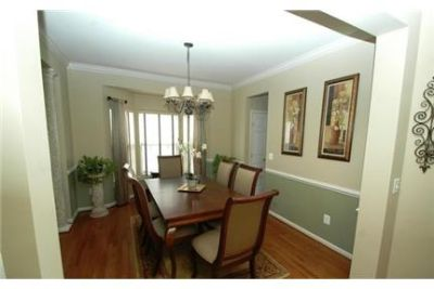 Outstanding Opportunity To Live At The Gainesville City Club. 2 Car Garage!