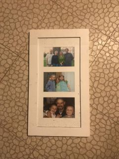 White frame. Holds 3 pictures