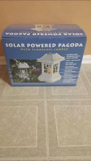 Solar power pagoda with flameless candle. Brand new