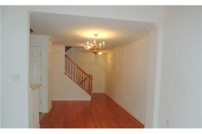 Freshly painted lovely townhome tucked away in private wood setting.