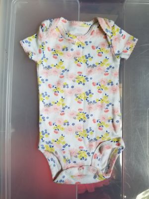 Newborn onesie. Check out my page for other clothing items