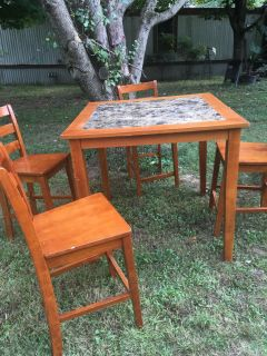 wood table and four chairs