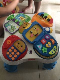 Fisher Price sit to stand play table for infant to toddler.
