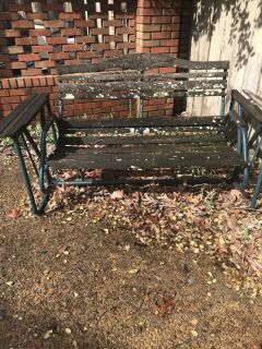 Metal glider in working condition. Wood panels need replacing