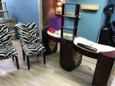 spa nail table with dryers, and two chairs