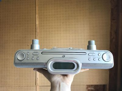 Sony. Under cabinet CD player and radio with remote. 4 screws included to install. Works great. Just no longer needed it.