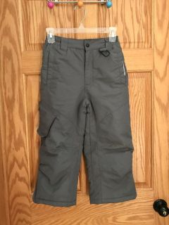 Athletech Grey Snow Pants, fully lined. Size 6/7. Two front pockets. One has a place to write name, address & phone #. One Velcro Pocket.