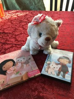 Jingle the husky with book and movie (you read to the dog and she interacts)