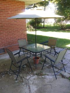 Small patio table with 4 chairs and umbrella