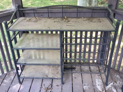 Outdoor metal bar with glass shelves
