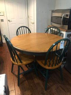 Kitchen table & 4 Chairs. Light oak table top/chair seats & dark Green pedestal and chair backs. See photos for detail.