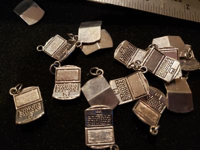 14 laptop charms (2 sets available)