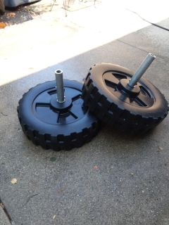 Two shore station boat lift wheels with axels