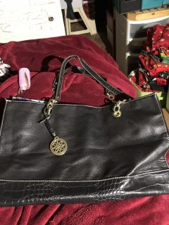 Black faux leather tote with floral interior