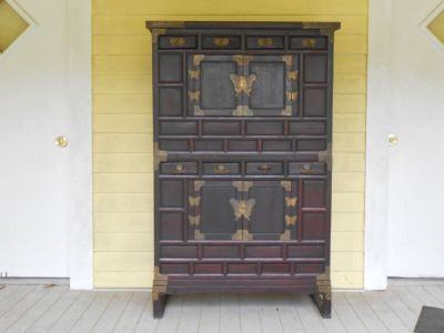 Elmwood and brass mounted two piece Korean clothes cupboard
