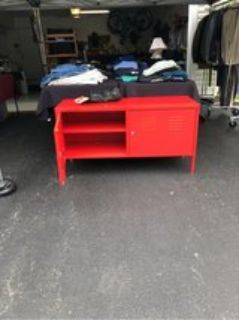 Bright red locker style TV cabinet