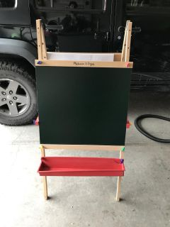 Melissa and Doug art easel. Chalkboard, dry erase board and paper roll.