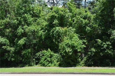 Beautiful and private 1/2 acre buildable lot in TimberCreek!