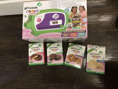 Like new Girl Scout cookie oven with several supplies