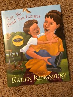 Let Me Hold You Longer by Karen Kingsbury, includes Bonus CD read by author, GUC, $5. Porch pick up only.