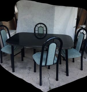 Table with 4 sturdy chairs. SERIOUS BUYERS PLEASE