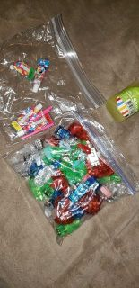 Sandwich bag FULL of finger lights.. comes with container of slime, and balloon bubble makers