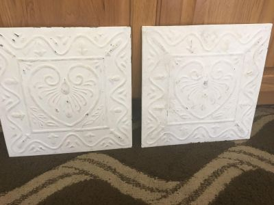 Set of 2 metal wall art both. Are 12x12