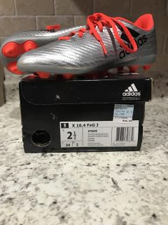 New in box Adidas soccer cleats. Silver and orange. $15