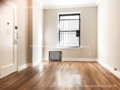 Studio Apartment with Street Views! This unit features an updated kitchen with a dishwasher and microwave!