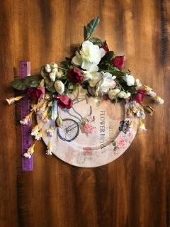 White, pink & red flowers on bike plate