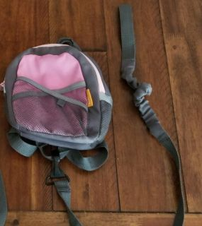 Child backpack with safety harness.
