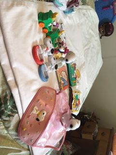 Snoopy Baby Items. 2 pc train set, 2 plastic tattlers, pink bib, small plush Snoopy, 2 vinyl books, 2 cardboard books the white 1 well loved
