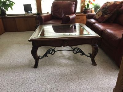 Beautiful glass top table with leather trim.