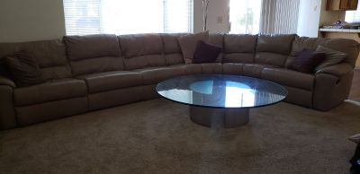 Leather sectional with reclining ends and matching recliner