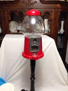 """Carousel Vintage Gum Ball Machine with stand. 1980's. Metal and glass. Works. Coin operated. 38"""" tall."""