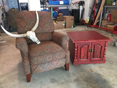 Recliner, side table, and skull!