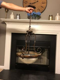 Chandelier with Bronze Accent and Sculpted Glass Globe