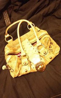 Small gold colored guess purse