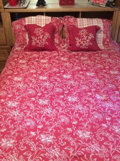 Gently used heavy red and beige spread with pillows and shams the yellowish place in picture is a shadow see other pixs for reverse side