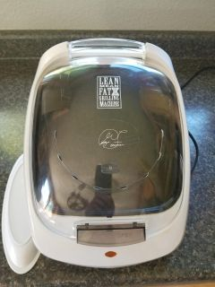 George Foreman Grill with Tray. Very Good Used/Clean Condition. Some scratches from basic ware.