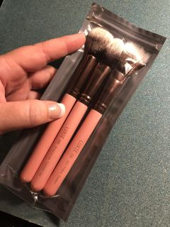 Three Luxie makeup brushes