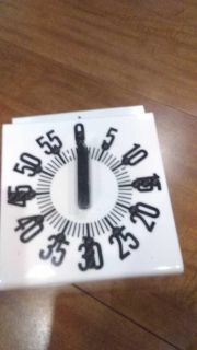 Large cooking timer, numbers are marked with dots at quarter hour, used for person with bad sight
