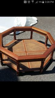 Glass top wooden coffee table