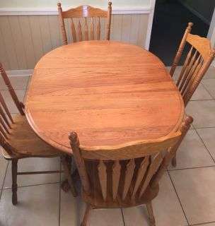 Kitchen/Dining solid wood table and 4 chairs