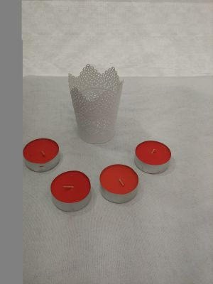 4 red candles and a decorative metal holder