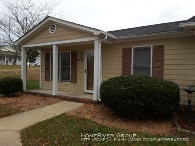 Large living room, end unit with a front porch and back patio that is surrounded with a privacy fence!