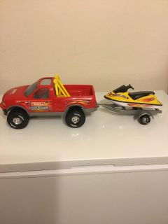 Truck and boat with trailer