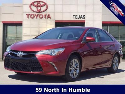 2016 Toyota Camry L (ruby flare pearl)