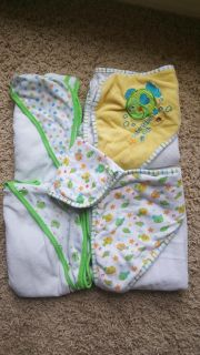 4 hooded baby towels and 1 washcloth.